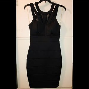 GODDESS BLACK. SHEER MESHED AND SLEEVELESS DRESS